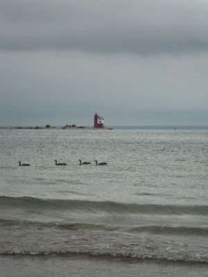 Round Island Lighthouse as seen from Mackinac Island on an overcast day image. Click for full size.