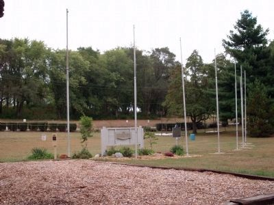The Eight Flag Poles - - image. Click for full size.
