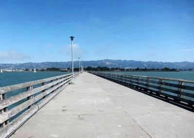 View of the Berkeley Municipal Pier, looking east from the end of the pier. image. Click for full size.