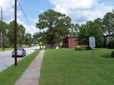 World War II POW Camp Marker as seen looking north along Hoover street image. Click for full size.