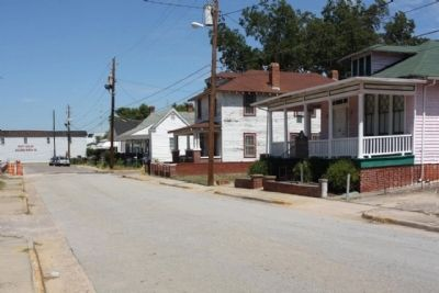 John McClinton Tutt Marker and house as seen looking north along Phillips Street image. Click for full size.