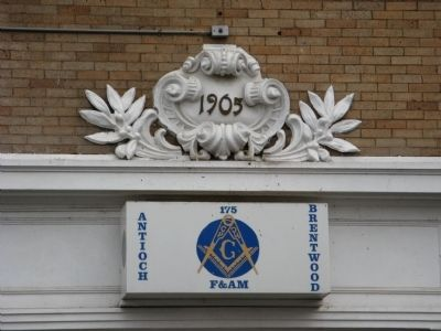 Sign and Architectural Detail Above Entrance Door image. Click for full size.