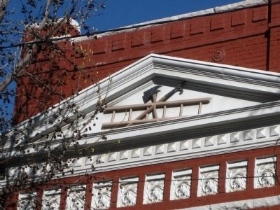 Hook, ax, and ladder - detail of north pediment image. Click for full size.