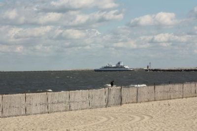 Cape May- Lewes Ferry seen along with Breakwater East End Lighthouse in background image. Click for full size.