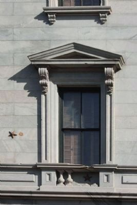 "The State House west wall window showing Union 2 cannonball strkes, indicated by ""stars"" image. Click for full size."