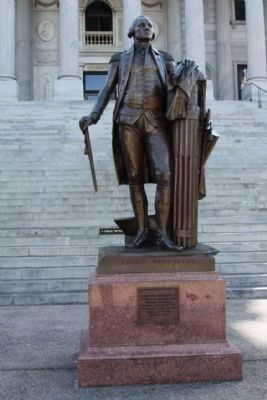 The State House George Washington Statue, north steps reads: image. Click for full size.