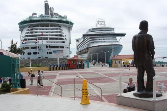 "Dr Albert Claudius (""Claude"") Wathey Marker and statue greet the Cruise ships in port image. Click for full size."