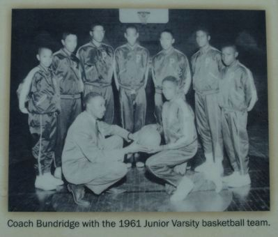 Coach Bundrige with the 1961 Junior Varsity basketball team image. Click for full size.
