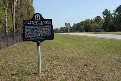 Turpentine Industry Community and Family Marker, looking northeast along State Road 24 image. Click for full size.