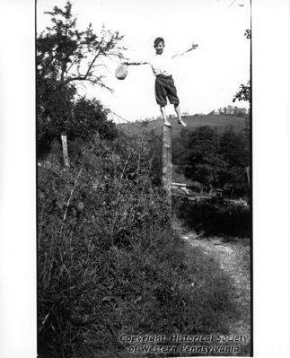 Delvin Miller balancing on a fence post image. Click for full size.