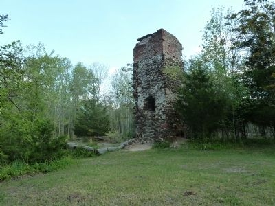 Remnants of the furnace and cotton mill chimney, facing East. image. Click for full size.