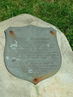 Plaque on rock at base of marker image. Click for full size.