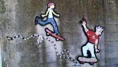 Skateboarders on Mosaic Wall image. Click for full size.
