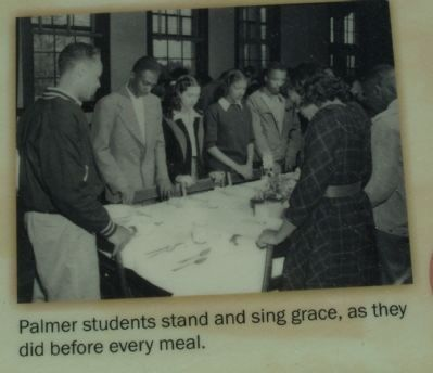 Students stand and sing grace, as they did before every meal. image. Click for full size.