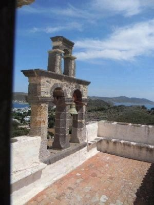 Roof of the Apocalypse Monastery with Patmos harbor in the background image. Click for full size.