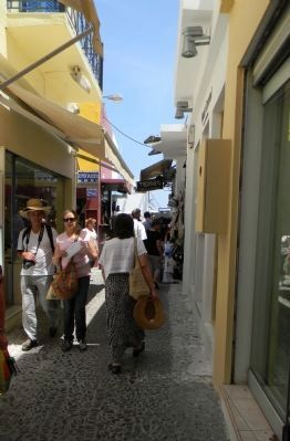 The narrow streets of Fira lead toward the cable car station image. Click for full size.