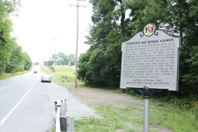 Interstate and Defense Highways Marker looking north along South Seton Avenue image. Click for full size.