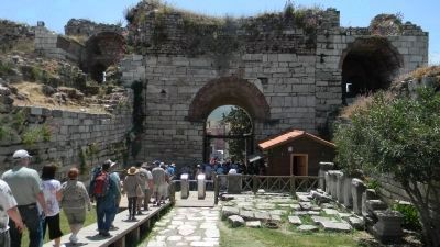 The Basilica of St. John - visitors exiting the ancient ruins via the Roman portal to the south image. Click for full size.