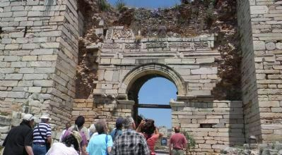 Visitors outside the Roman portal image. Click for full size.