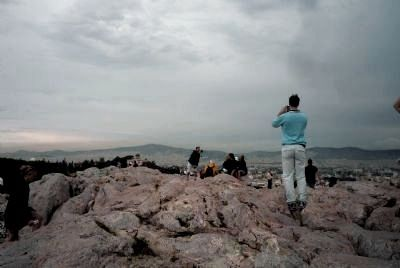 Tourists on the marble outcrop, Areopagus Hill, Athens image. Click for full size.
