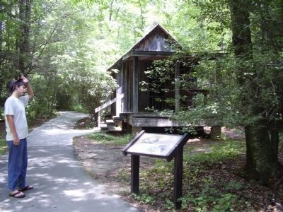 Hell Hole marker in front of cabin image. Click for full size.