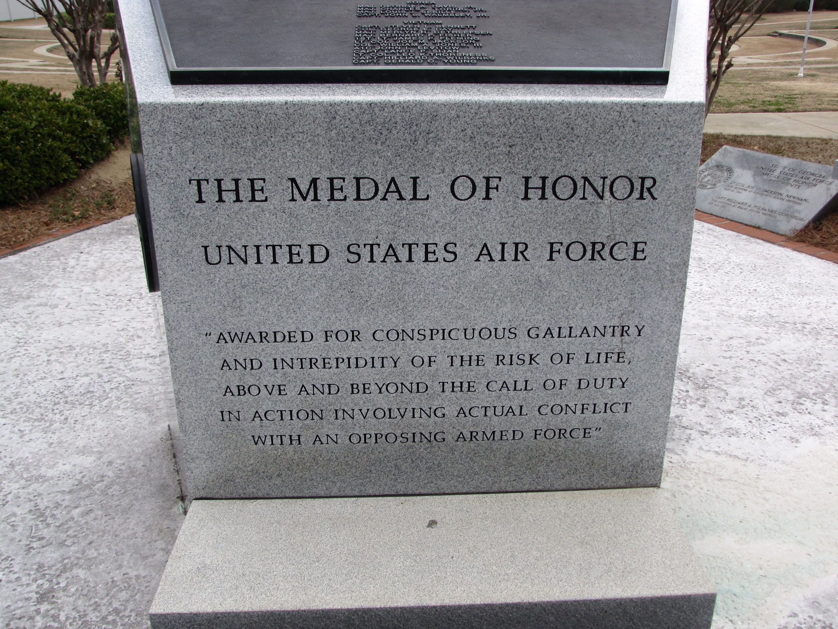 Text on base of memorial