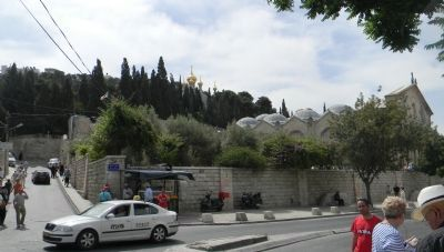 Jerico Road with the Garden of Gethsemane and the Basilica behind the stone wall image. Click for full size.