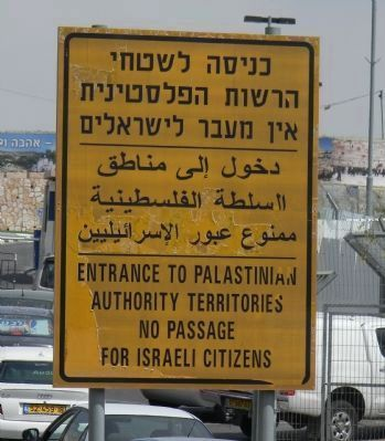 The Palestinian Frontier - signage on the road between Jerusalem to Bethlehem image. Click for full size.
