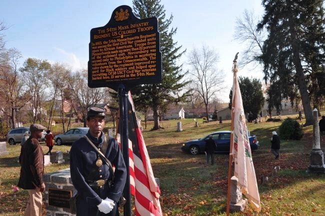 Civil War re-enactor Howard Lambert (B Co. 54th MVI) posses at the Marker during image. Click for full size.