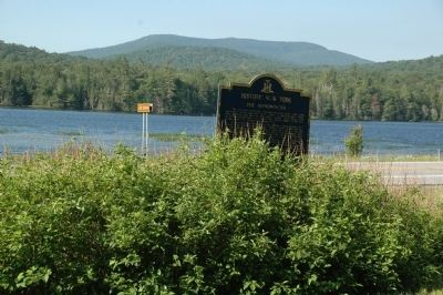 The Adirondacks Marker, Lake Durant Across the Road image. Click for full size.