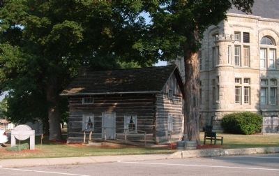 Log Cabin - - South/East Corner of Courthouse image. Click for full size.