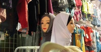 Hajibs for sale in a marketplace dress shop image. Click for full size.