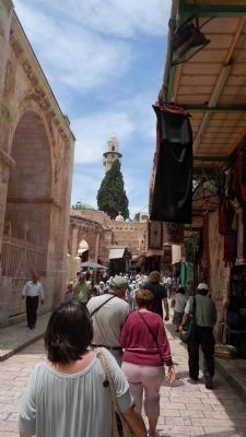 Pilgrims approach the Church of the Holy Sepulchre, navigating by the prominent minaret image. Click for full size.