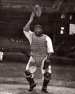 Negro League baseball catcher Josh Gibson throwing mask into air image. Click for full size.