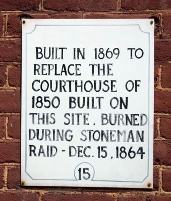 Sign on Courthouse Wall image. Click for full size.