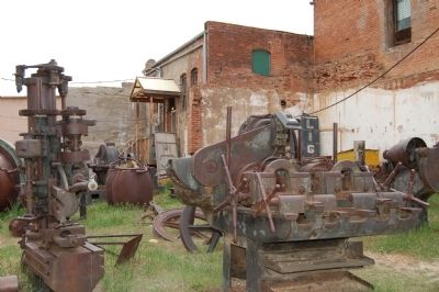 The Victor Lowell Thomas Museum mining machinery exhibit image. Click for full size.
