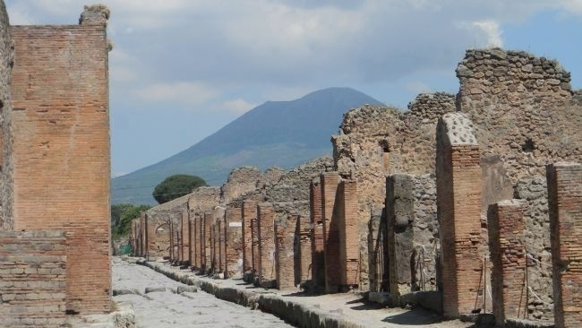 An excavated street near the Forum in Pompeii<br>- Mt. Vesuvius looming five miles to the northwest. image. Click for full size.