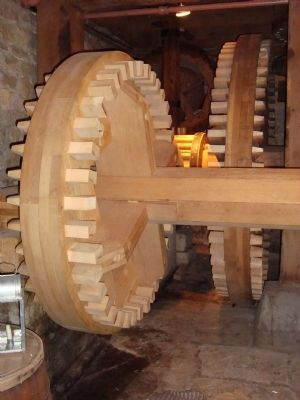 Wooden gears turned by the waterwheel image. Click for full size.