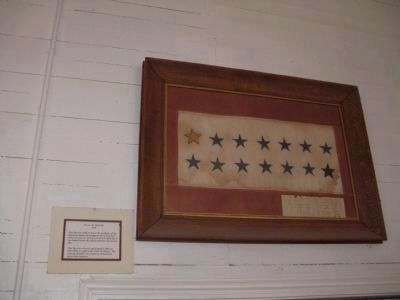 Flag on Display on Back Wall of Schoolhouse image. Click for full size.