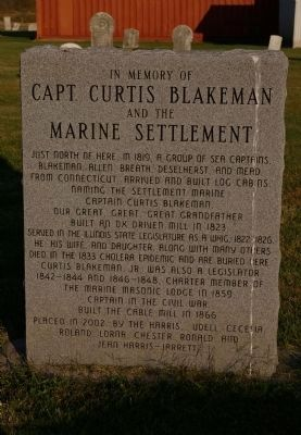 Capt. Curtis Blakeman and the Marine Settlement Memorial image. Click for full size.