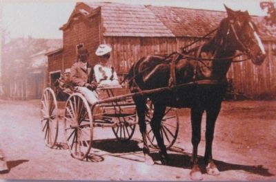 Close up of photo on marker, with the stable in the background image. Click for full size.