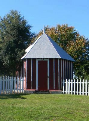 The hexagonal outbuilding and boxwood trees referred to in the text. image. Click for full size.