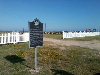 Marker sits just outside the Port Bolivar cemetery image. Click for full size.