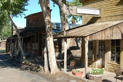 Strasburger's Colorado Store, on left in the shade. image. Click for full size.