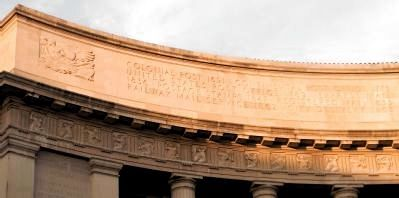 Inscription above the frieze, north end, west side entablature image. Click for full size.