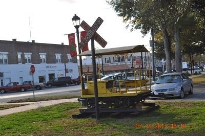 Railroad Crossing sign in front of Train Depot image. Click for full size.