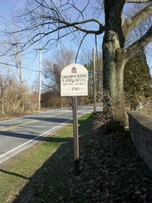 Okehocking Land Grant Marker next to cemetery wall image. Click for full size.