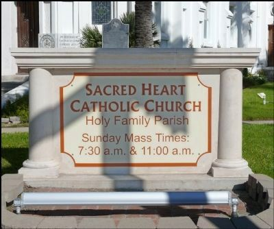 Sacred Heart Church Sign With Marker Behind image. Click for full size.