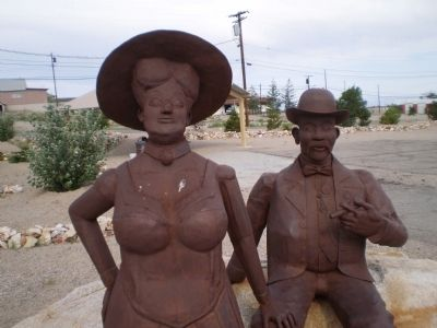 Welded steel sculpture of Jim and Belle Butler image. Click for full size.
