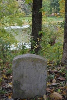 The memorial marker on the river to the Rhodes family image. Click for full size.